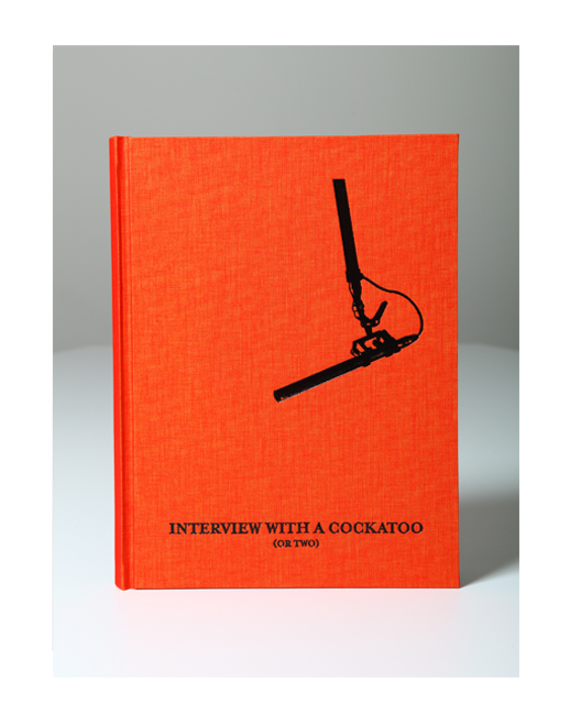 The front cover of 'Interview with a Cockatoo (or Two)', Hard cover Linen in Orange with a Custom Emboss in Black. ©Leila Jeffreys